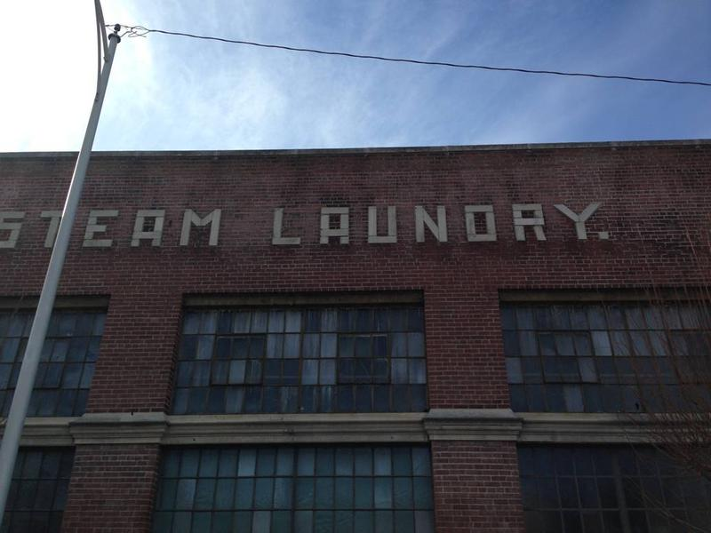 The original sign at Pearl Laundry downtown remains unchanged. Historic Preservation Officer Dennis Au said the letters were likely laid by masons who interpreted the instructions from an architect, hence the period.