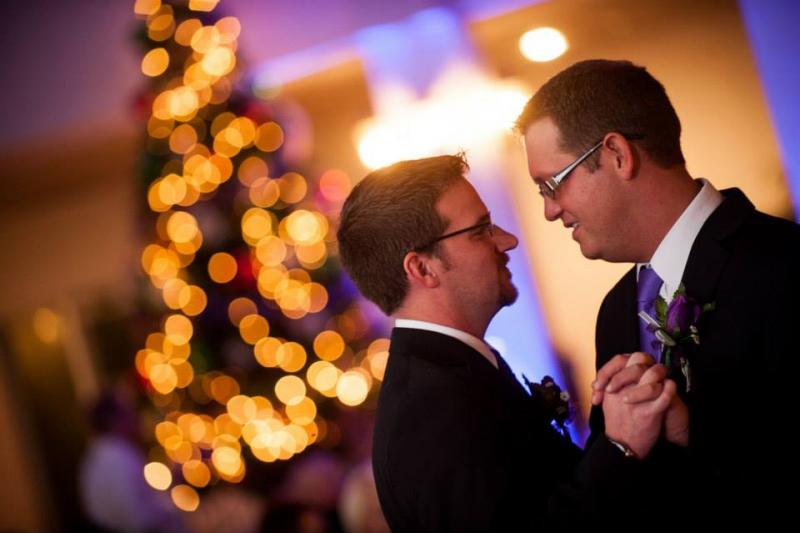 Robert Owen (left) and Alex Jarvis (right) celebrated  their wedding in Evansville one month after the ceremony in Iowa. Mayor Lloyd Winnecke and several city council members were among the 80 people in attendance, despite treacherous road conditions.