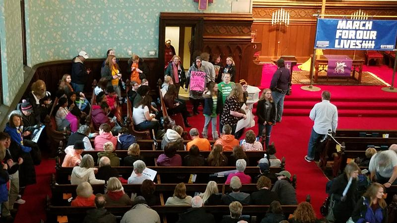 An overflow crowd at First Presbyterian Church before the march
