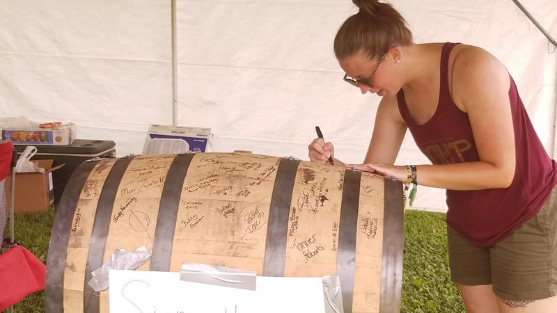 The O.Z. Tyler distillery had visitors sign a barrel that will be used in their warehouse after the festival