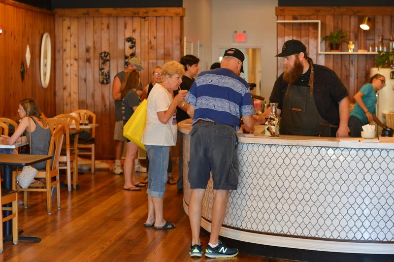 David and Kendra Rudibaugh serve a rush of customers during a Franklin Street Bazaar. White Swan Coffee Lab at The Hub opened across from the West Branch Library in the summer of 2018 and has experienced a warm welcome in the community.