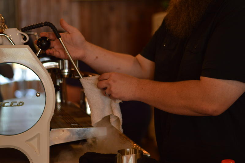 David Rudibaugh cleans the steam nozzle of his espresso machine between drinks.  He says the