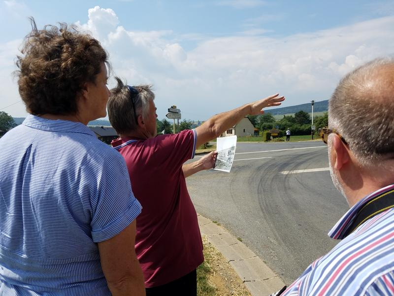 Richard Tucker points out a location to Nancy Hasting and Chris Sims outside Cheuveges.