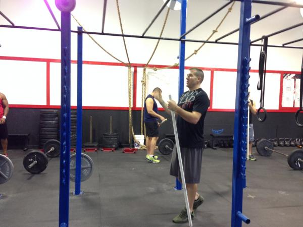 """Crossfit trainer Jared Wagner coaches his clients through a """"WOD"""", or workout of the day."""