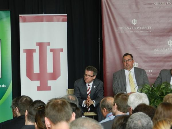 Evansville Mayor Lloyd Winnecke waits for the IU trustees vote Friday.