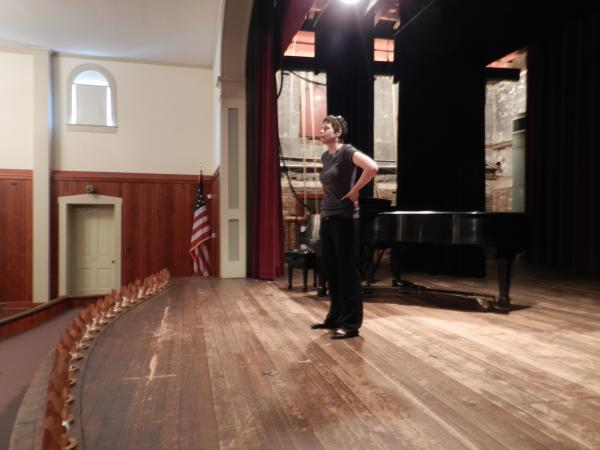 Amanda Bryden, collections manager for Indiana State Museum Historic Sites, looks out to the auditorium at the historic Thrall's Opera House. Over the decades, the venue has hosted performances, weddings, a filling station and now, the New Harmony Music Festival.
