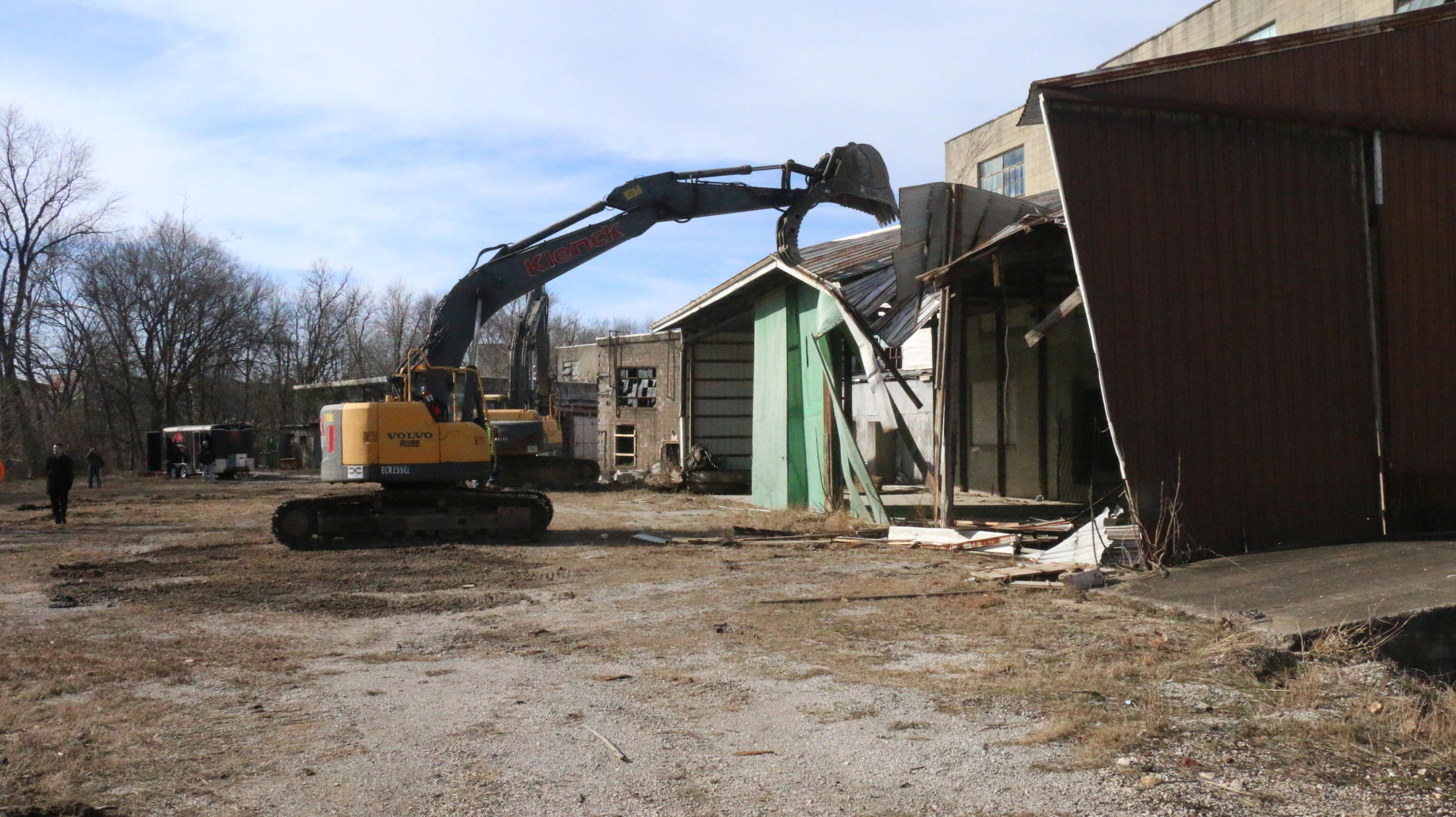 The Excavator Being Used To Start Demolition Of The Former Jasper Cabinet  Company Building.