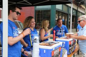 Volunteers pour beer in the Christian Moerlein Beer Garden