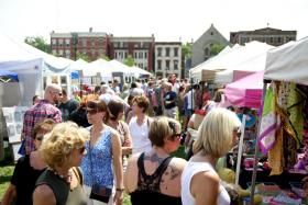 Shoppers peruse the dozens of vendor booths at last year's City Flea