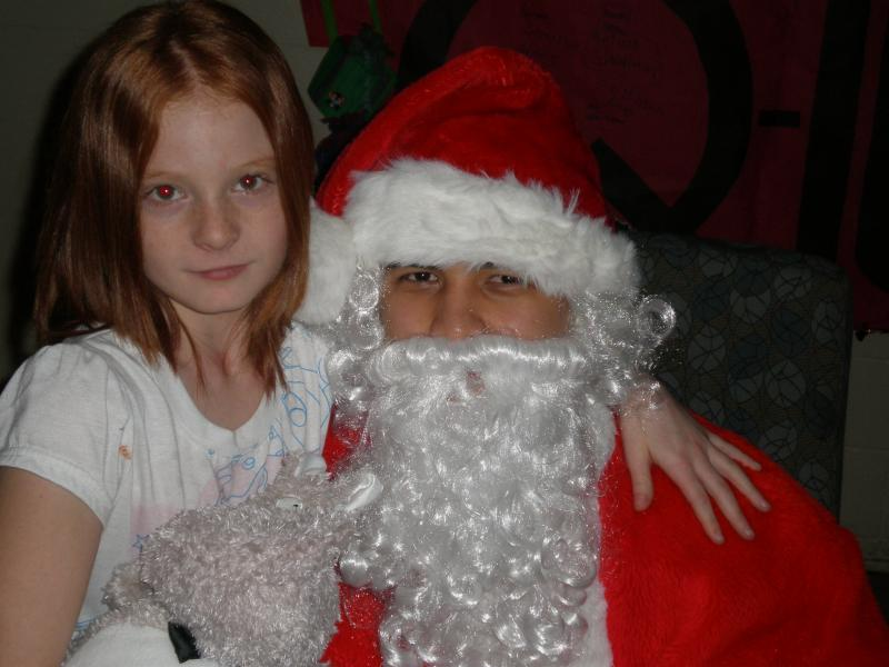 Sarah and Santa at St. Joseph Orphanage Christmas Party