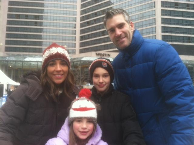 The Levitsky family enjoying a day ice skating on Fountain Square.