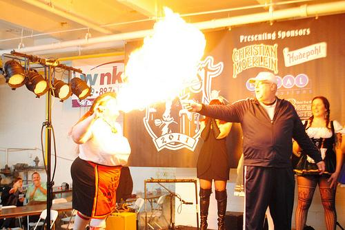 During the Sausage Queen competition, a finalist shows off her fire-breathing skills.