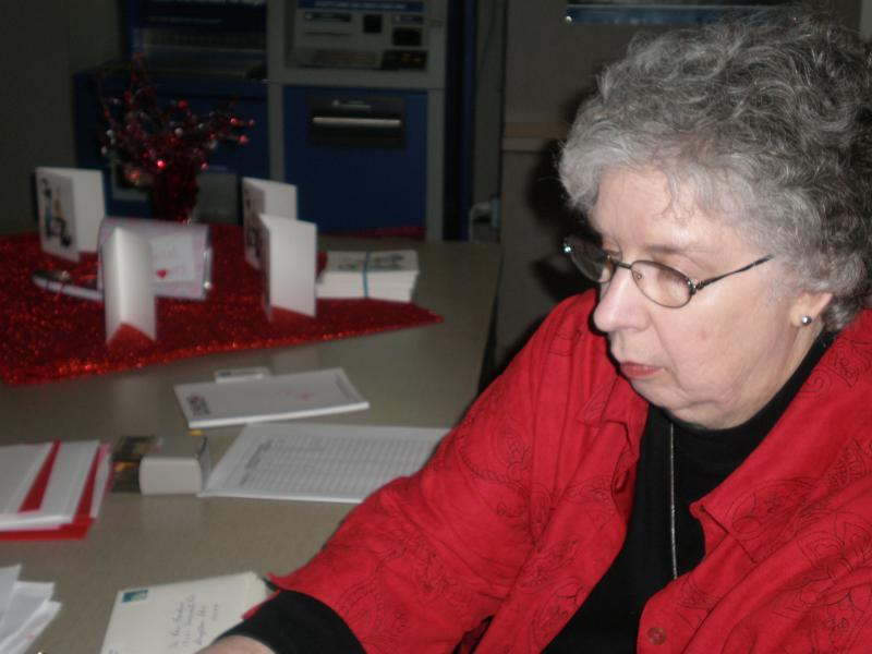 Valentine Lady of 2008 Kay Napier busy at work stamping Valentines.