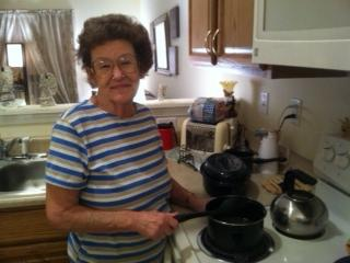 Peggy Ohmer stands at her the stove where she'll prepare a Thanksgiving Dinner