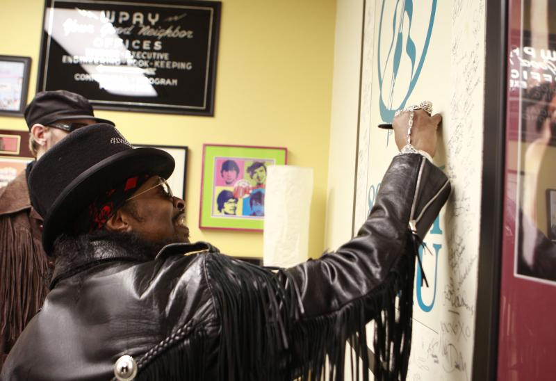 Bootsy Collins signs the WNKU Wall of Fame