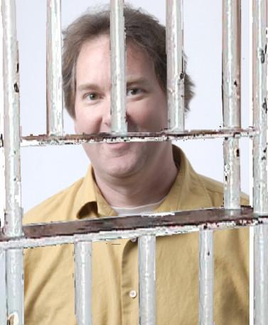 John Patrick behind bars