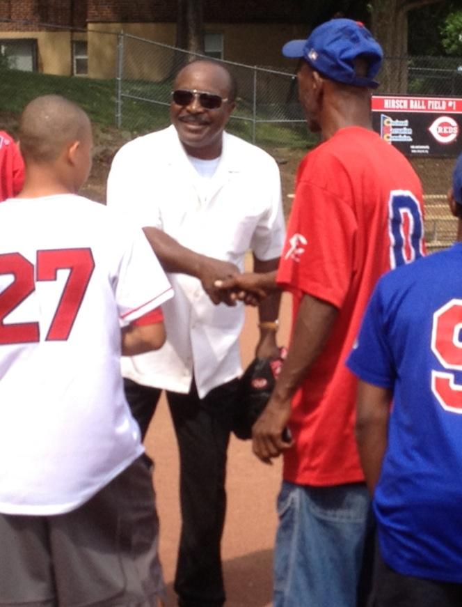 Hall of Famer Joe Morgan talks with little league coaches