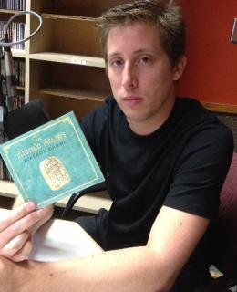 "Adam Singer at WNKU with the CD in hand ""Jukebox Drawl"""