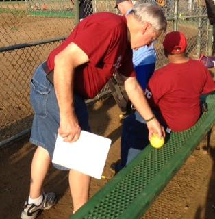 Dave Kremer, Teddy's dad, getting ready to keep score and root for his son's team