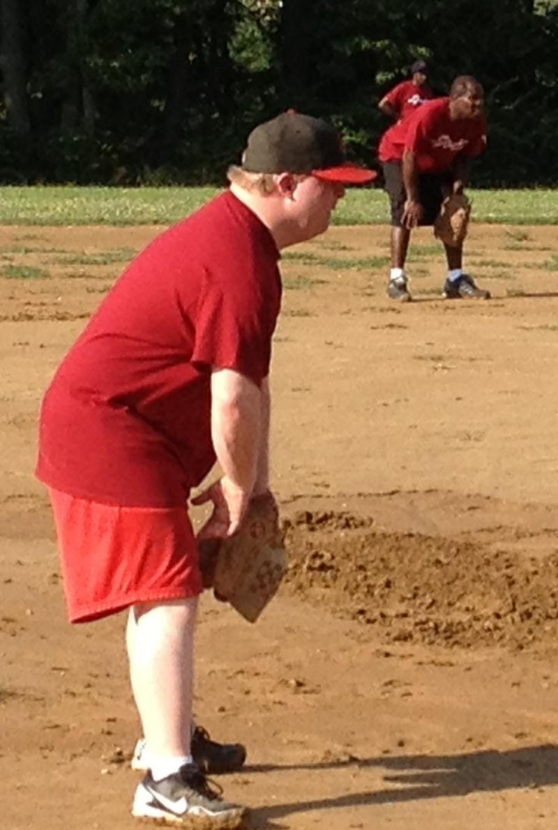 Teddy Kremer playing 3rd base for his softball team