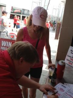 Teddy Kremer at Fan Accommodations signs an autograph for fan Karen Rennekamp