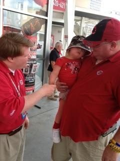 Teddy Kremer greets fans, Jenny Lynn and Chris Kalla at Great American Ball Park