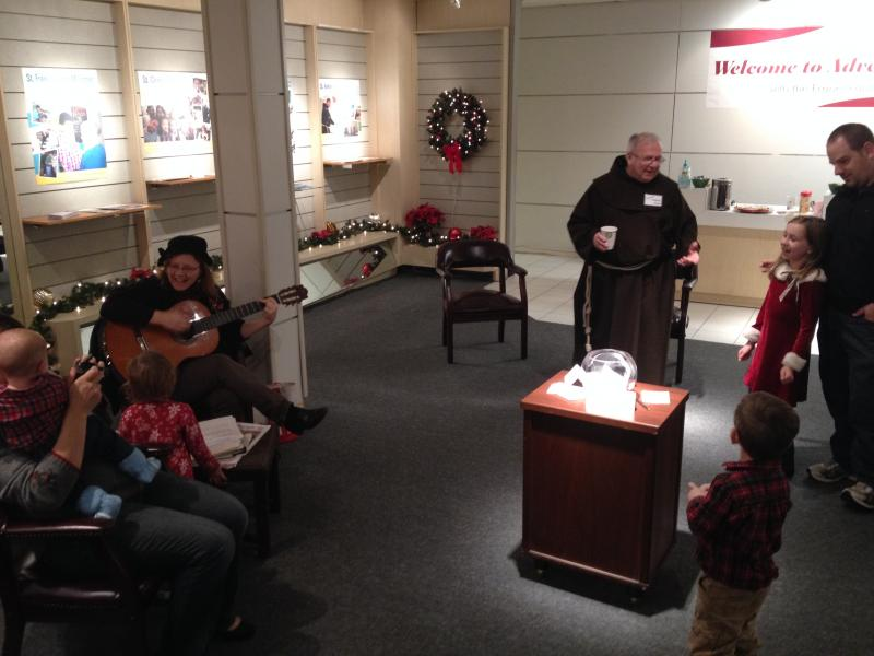 Father Fred sings with visitors