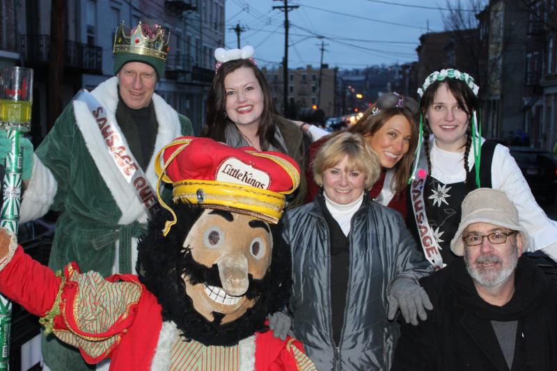 Mary Peale and Mr. Rhythm Man pose with Little King and his Sausage Queens