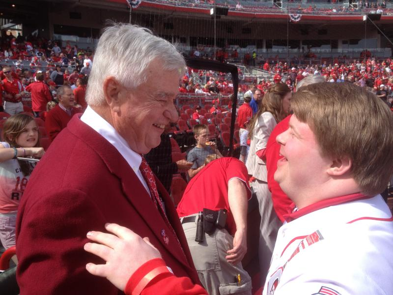 Reds CEO Bob Castellini talks with honorary batboy/grand marshal Teddy Kremer before Opening Day game 2014