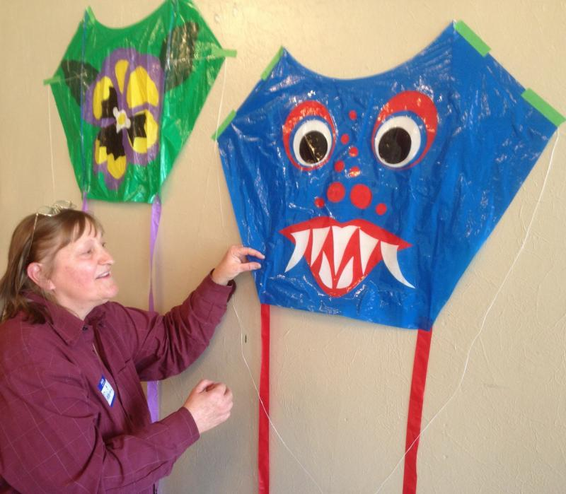 Debbie Von Bokern displays kites at Happen Inc.