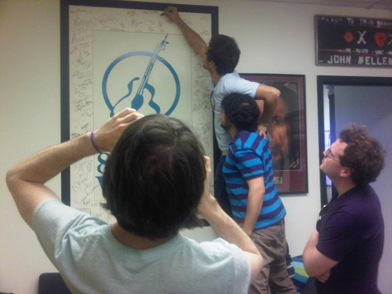 Walk the Moon signing the WNKU Wall of Fame