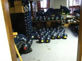 Michigan State Police helmets and riot gear in a storage room at the state Capitol.