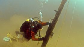 A diver examines what could be the bowsprit of the Griffin in Lake Michigan.
