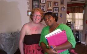 Amy DeRosa in her living room with Wellmore caseworker, Candra Bacote