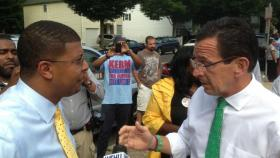 Malloy talks (calmly) to Mayoral candidate Kermit Carolina in New Haven.