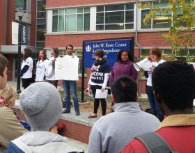 Students listen as activists voice their support for the seven women.