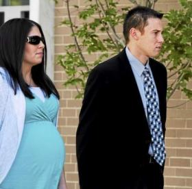 East Haven police officer Dennis Spaulding and his wife leave court in late September in Hartford.