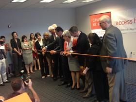 Governor Dannel Malloy and others at a ribbon-cutting for Access Health CT.