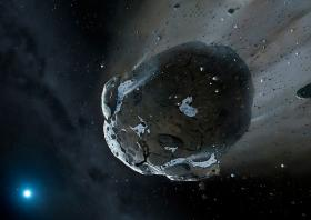 Artist's view ofa  watery asteroid in white dwarf star system GD 61.