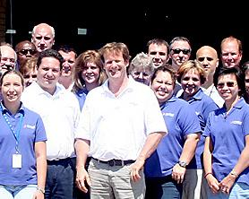 Some of the staff of Proton OnSite with CEO and President Robert J. Friedland in Wallingford.