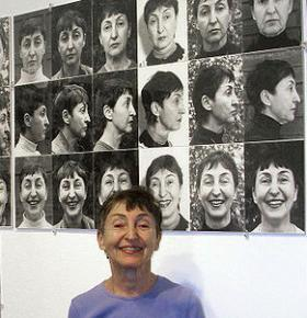 """Artist Athena Tacha in front of her work, """"36 Years of Aging."""""""