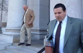 Ray Soucy, left, walks away from reporters after his sentencing Monday. His lawyer, Steven B. Rasile, is at right.