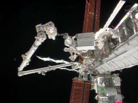 Waterbury native Rick Mastracchio holds the degraded pump module while the International Space Station's robotic arm guides the module to a grapple fixture.
