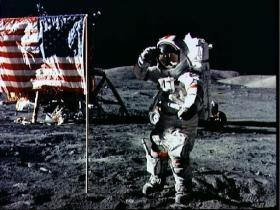 Astronaut Eugene Cernan salutes deployed U.S. flag on the lunar surface
