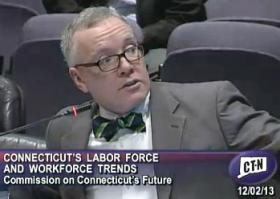 Economist Patrick Flaherty of the Connecticut Department of Labor's Office of Research presented jobs data Monday morning.