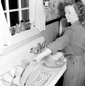Geraldine Fain doing the breakfast dishes in 1946.