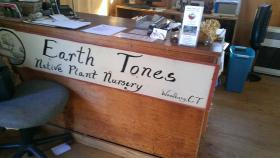 The sign inside Earth Tones Native Plant Nursery. Lisa and Kyle estimate more than 10,000 plants grow on the property. All are species native to Connecticut.
