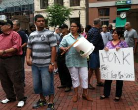 Fast food workers picketed while on strike last summer at State House Square in Hartford.