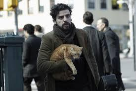 "Oscar Isaace plays Llewyn Davis, a character based loosely on folk guitarist, Dave Van Ronk, in the Coen Brother's new film, ""Inside Llewyn Davis."""