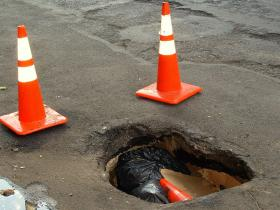 Potholes in New York City. This winter's multiple frost/thaw cycles are expected to contribute to a high volume of potholes in the spring.